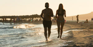coupleRunning on Beach