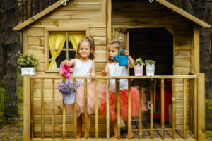 kids playing in tree house